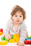 Toddler playing with building blocks Royalty Free Stock Photos