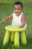 Toddler playing with chair Royalty Free Stock Photography