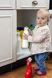 Toddler playing with cleaning products. Little child playing with cleaning products at home Stock Images