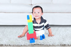 Toddler playing with colourful blocks Royalty Free Stock Photos