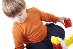 Toddler playing constructions Stock Images
