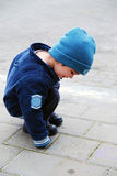 Toddler Playing with Crayons. On a sidewalk Royalty Free Stock Photo