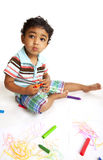 Toddler Playing with Crayons. On White Background stock image