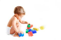 Toddler playing with cubes Royalty Free Stock Photo