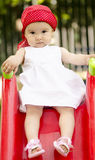 Toddler playing. Cute girl having fun on playground side stock photo