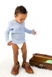 Toddler playing with Dad's shoes. Playful African toddler boy having fun with Dad's shoes Royalty Free Stock Images