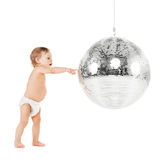Toddler playing with disco ball Stock Image