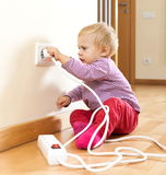 Toddler playing with  electric equipment Royalty Free Stock Image