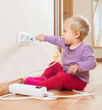 Toddler playing with electricity Royalty Free Stock Photos