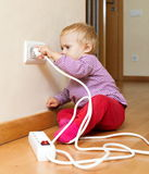 Toddler playing with electricity Stock Images