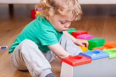 Toddler playing on the floor Royalty Free Stock Images