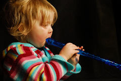 Toddler playing flute royalty free stock photos