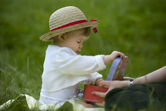 Toddler playing in the garden with memo cards Royalty Free Stock Photography