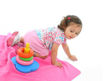 Toddler playing with generic toy. Little girl playing and having fun with generic toy. More pictures of this baby at my gallery Royalty Free Stock Photos