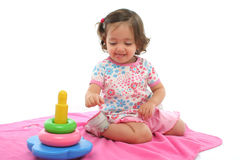 Toddler playing with generic toy. Little girl playing and having fun with generic toy. More pictures of this baby at my gallery stock photos
