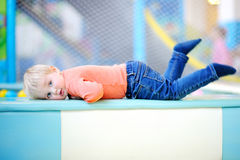 Toddler playing at indoors playground Royalty Free Stock Images
