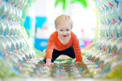 Toddler playing at indoors playground Royalty Free Stock Image