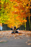 Toddler playing with leaves Stock Images