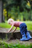 Toddler playing outdoors Royalty Free Stock Photography