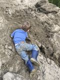 Young boy playing in the dirt Royalty Free Stock Photo