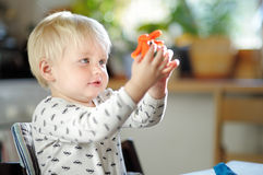 Toddler playing with play dough Stock Image