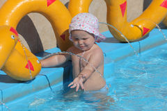 Toddler playing in a pool Stock Photo