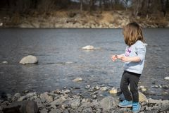 Toddler playing on the riverside royalty free stock images