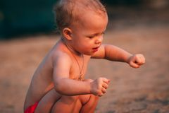 Toddler Playing With Sand Stock Photography