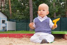 Toddler playing in the sand Stock Photos