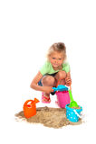 Toddler is playing in the sand Stock Image