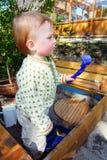 Toddler playing in sandbox Royalty Free Stock Photography