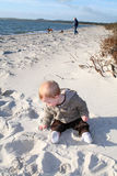 Toddler playing on sandy beach Royalty Free Stock Photography
