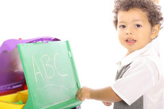 Toddler playing school Stock Photo
