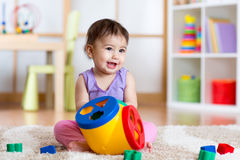 Toddler playing with a shape sorter. Toddler girl playing with a shape sorter toy Stock Image