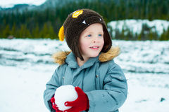 Child playing in the snow Royalty Free Stock Photo