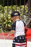 Toddler playing in some water. At a splash pad Royalty Free Stock Image