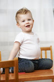 Toddler Playing on Table Royalty Free Stock Image