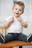 Toddler Playing on Table Stock Photo
