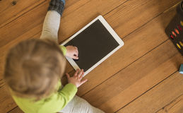 Toddler playing with Tablet Stock Images