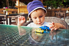 Toddler playing with toy cars Royalty Free Stock Photos