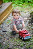 Toddler Playing with a Toy Fire Truck Outside - Series 2 Stock Images