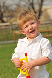 Toddler playing with toy trumpet Stock Photography