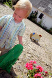 Toddler playing with toys Stock Photos