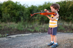 Toddler playing the violin Royalty Free Stock Image