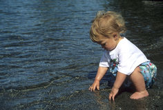 Toddler playing in water Stock Photo