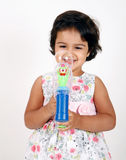 Toddler playing with water bubble gun Royalty Free Stock Photo