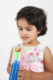 Toddler playing with water bubble gun Royalty Free Stock Images