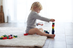 Toddler playing with wooden blocks Royalty Free Stock Images