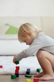 Toddler playing with wooden blocks Royalty Free Stock Image