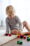 Toddler playing with wooden blocks Stock Image